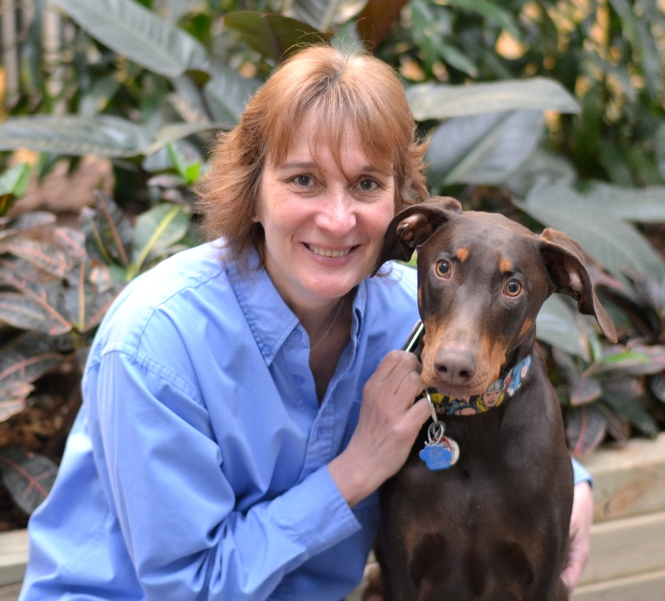 Senior Director of Operations CJ Bentley and her adopted dog, Rogue